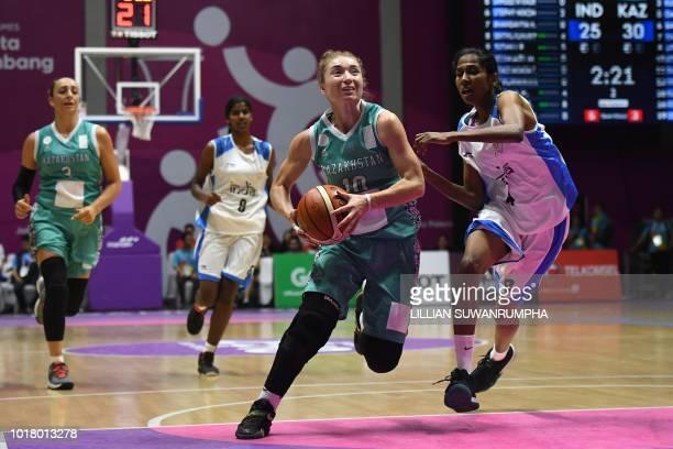 Kazakhstan's Olga Kolesnikova tries to get past India's Prasannan Geetha Anjana in their women's basketball preliminary Group A game between India...