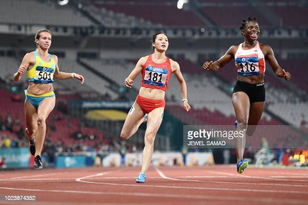 TOPSHOT Kazakhstan's Olga Safronova China's Wei Yongli and Bahrain's Edidiong Odiong compete in the final of the women's 100m athletics event during...