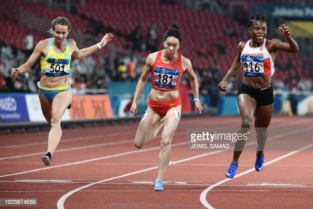 Kazakhstan's Olga Safronova China's Wei Yongli and Bahrain's Edidiong Odiong compete in the final of the women's 100m athletics event during the 2018...
