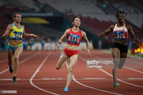 Kazakhstan's Olga Safronova China's Wei Yongli and Bahrain's Edidiong Odiong compete in the final of the women's 100m athletics event on day eight of...
