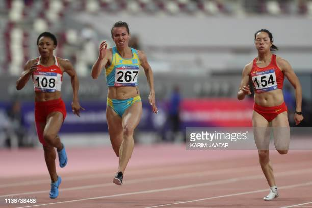 Kazakhstan's Olga Safronova competes during the Men's 100m Final race on the second day of the 23rd Asian Athletics Championships at Khalifa...