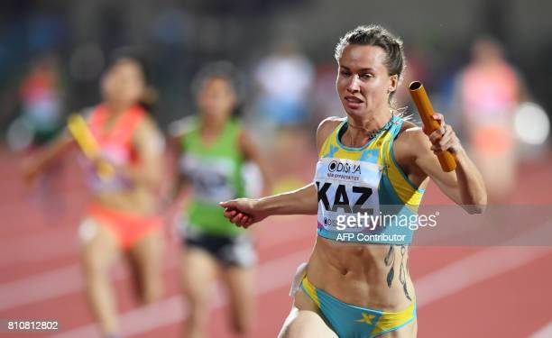 Kazakhstan's Olga Safronova crosses the finish line to win the women's 4 X 100m relay during the third day of the 22nd Asian Athletics Championships...