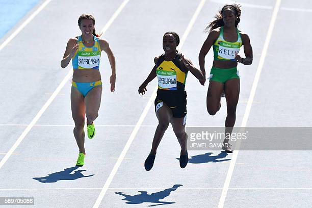 Kazakhstan's Olga Safronova Jamaica's Veronica CampbellBrown and British Virgin Islands's Ashley Kelly compete in the Women's 200m Round 1 during the...