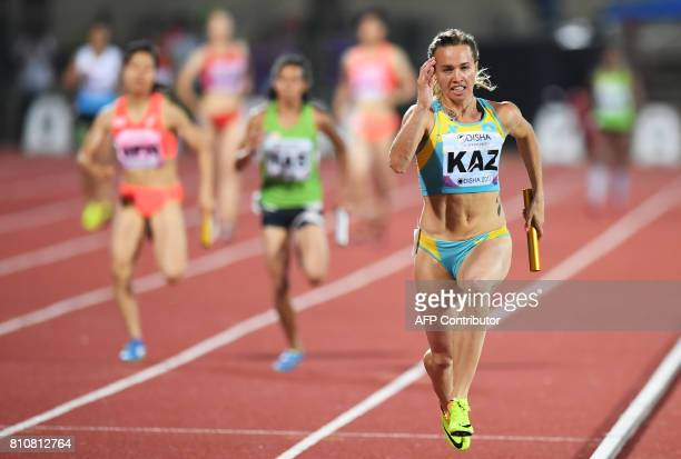 Kazakhstan's Olga Safronova takes the last relay to win the women's 4 X 100m relay during the third day of the 22nd Asian Athletics Championships at...