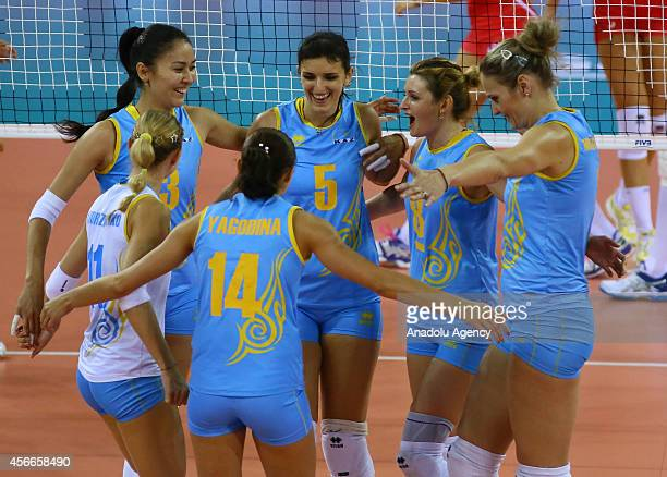 Kazakhstan's players celebrate after a point during the 2014 FIVB Volleyball Women's World Championship Group F volleyball match between Bulgaria and...