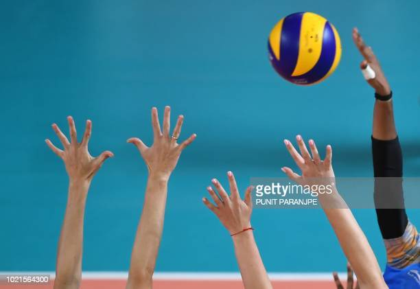 Kazakhstan's players defend the net against India during the women's group B preliminary volleyball match between India and Kazakhstan at the 2018...