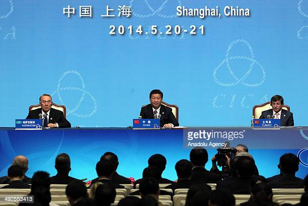 Kazakhstan's President Nursultan Nazarbayev Chinese President Xi Jinping and Turkish Foreign Minister Ahmet Davutoglu attend a press conference...