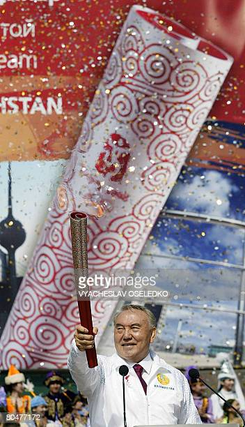 Kazakhstan's President Nursultan Nazarbayev holds the Olympic torch at Medeu speedskating stadium up in the mountains outside Almaty on April 02 2008...