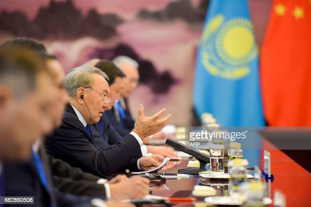 Kazakhstan's President Nursultan Nazarbayev neets with Chinese Premier Li Keqiang at the Great Hall of the People in Beijing on May 14, 2017. China...