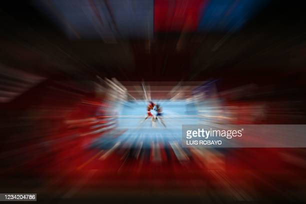 Kazakhstan's Saken Bibossinov and Puerto Rico's Yankiel Rivera Figueroa fight during their men's fly preliminaries boxing match during the Tokyo 2020...