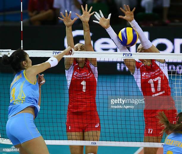Kazakhstan's Sana Anarkulova in action against Diana Nenova and Strashimira Filipova of Bulgaria during the 2014 FIVB Volleyball Women's World...