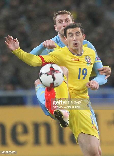 Kazakhstan's Sergei Maliy vies with Romania's Bogdan Stancu during the WC 2018 football qualification match between Kazakhstan and Romania in Astana...