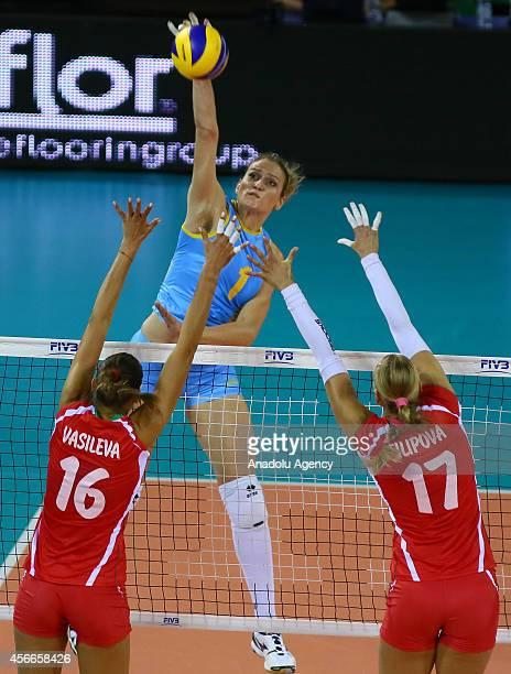 Kazakhstan's Tatyana Mudritskaya in action against Elitsa Vasileva and Strashimira Filipova of Bulgaria during the 2014 FIVB Volleyball Women's World...