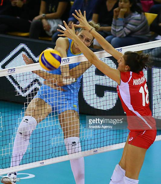 Kazakhstan's Tatyana Mudritskaya in action against Emiliya Nikolova of Bulgaria during the 2014 FIVB Volleyball Women's World Championship Group F...