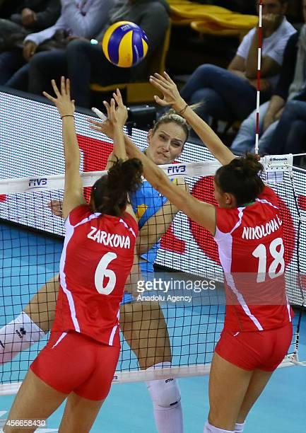 Kazakhstan's Tatyana Mudritskaya in action against Tsvetelina Zarkova and Emiliya Nikolova of Bulgaria during the 2014 FIVB Volleyball Women's World...