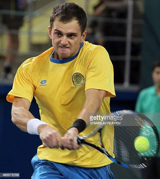 Kazakhstans tennis player Alexander Nedovyesov returns the ball to Italys tennis player Fabio Fognini during their Davis Cup World Group first round...