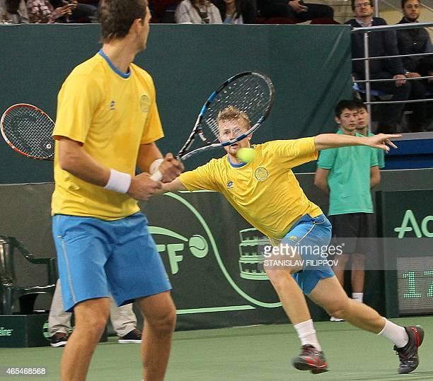 Kazakhstans tennis player Andrey Golubev and Aleksandr Nedovyesov return the ball to Italys tennis players Fabio Fagnini and Simone Bolelli...