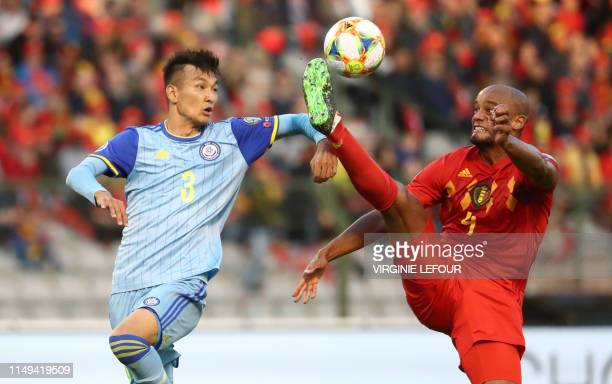 Kazakhstan's Toktar Zhangylyshbay and Belgium's Vincent Kompany fight for the ball during a soccer game between Belgian national team the Red Devils...