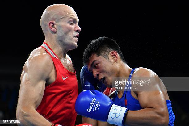 Kazakhstan's Vassiliy Levit fights China's Yu Fengkai during the Men's Heavy match at the Rio 2016 Olympic Games at the Riocentro Pavilion 6 in Rio...