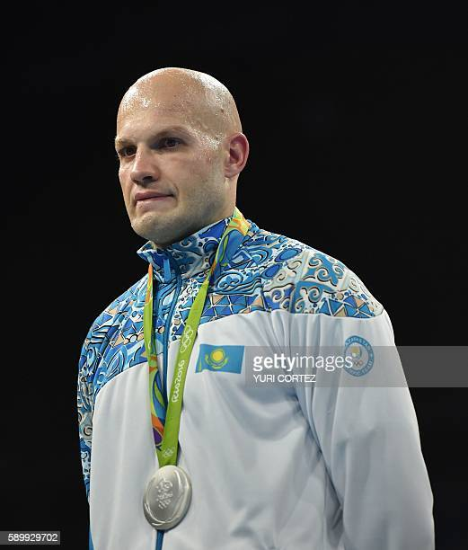 Kazakhstan's Vassiliy Levit poses on the podium with a medal following a boxing match at the Rio 2016 Olympic Games at the Riocentro Pavilion 6 in...