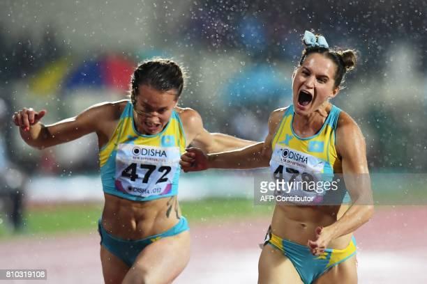 Kazakhstan's Viktoriya Zyabkin celebrates after winning the Gold Medal as Kazakhstan's Olga Safronova places second in women's 100m event during the...