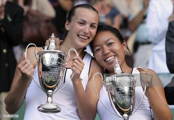Kazakhstan's Yaroslava Shedova and US Vania King hold the trophys after winning against Russia's Elena Vesnina and Russia's Vera Zvonareva in the...