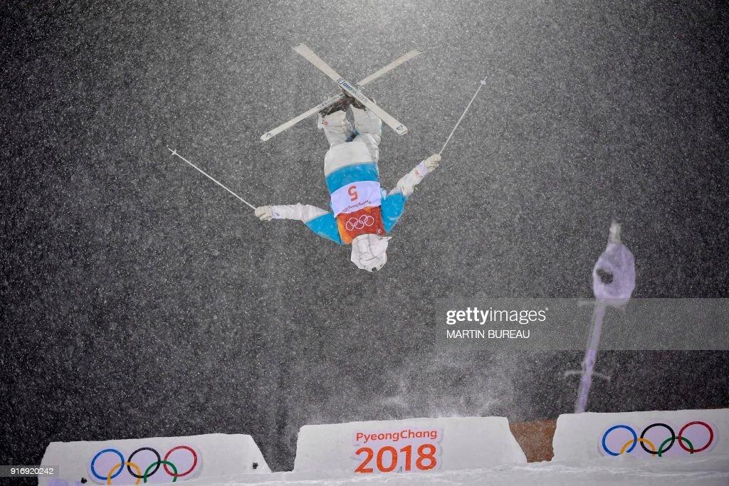 TOPSHOT - Kazakhstan's Yulia Galysheva competes in the women's moguls final 2 during the Pyeongchang 2018 Winter Olympic Games at the Phoenix Park in Pyeongchang on February 11, 2018. / AFP PHOTO / Martin BUREAU