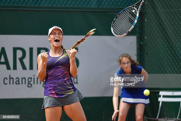 Kazakhstan's Yulia Putintseva celebrates after winning her third round match against Italy's Karin Knapp at the Roland Garros 2016 French Tennis Open...