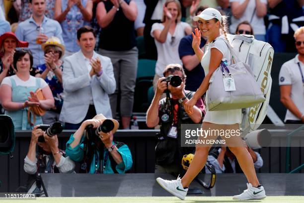 Kazakhstan's Yulia Putintseva smiles as she leaves the pitch after winning Japan's Naomi Osaka during their women's singles first round match on the...