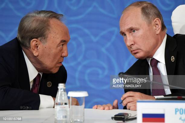 Kazakhtan's President Nursultan Nazarbayev and Russian President Vladimir Putin take part in the signing ceremony at the 5th Caspian Summit in Aktau...