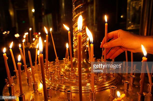 Kazan cathedral Russian orthodox believer lights candles