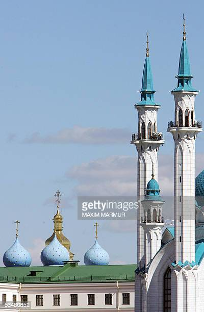 Picture taken 25 August 2005 shows Kul Sharif mosque and Church of the Annunciation at the Kazan's KremlinRussia's political elite this weekend pays...