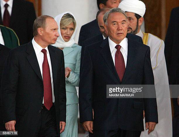 Russian President Vladimir Putin accompanies Kazakhstan President Nursultan Nazarbayev as they leave the mosque Kul Sharif at Kazan's Kremlin 26...