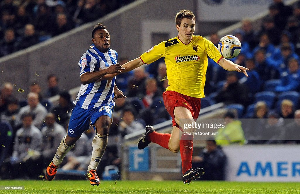 Kazenga Lua Lua of Brighton & Hove Albion chases down Watford's Tommie Hoban during the npower Championship match between Brighton & Hove Albion and Watford at The Amex Stadium on December 29, 2012 in Brighton England.