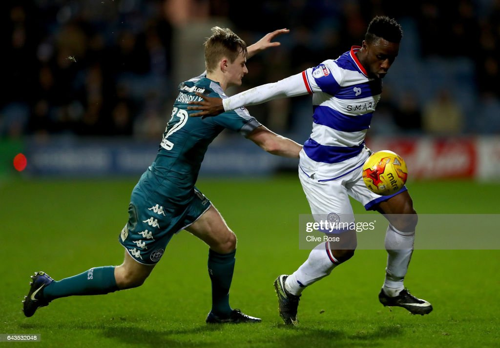 Kazenga LuaLua of Queens Park Rangers is tracked by Callum Connolly of Wigan during the Sky Bet Championship match between Queens Park Rangers and Wigan Athletic at Loftus Road on February 21, 2017 in London, England.