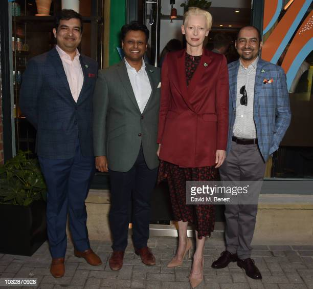 Kazi Inam Ahmed Ahsan Akbar Tilda Swinton and K Anis Ahmed attend the launch of Teatulia Tea Bar in Covent Garden on September 13 2018 in London...