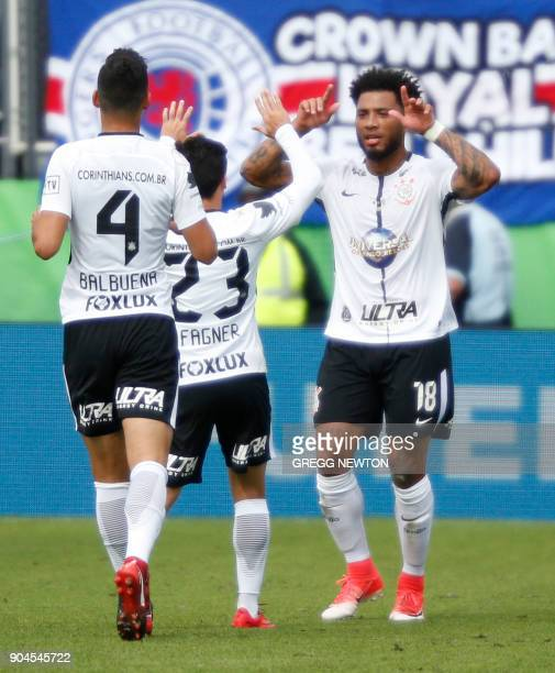 Kazim of Brazilian club Corinthians celebrates with teammates after scoring a first half goal against Scottish club Rangers FC during their Florida...