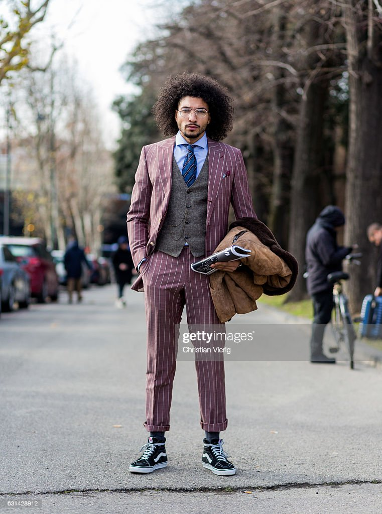 Kazim Sahin is wearing a pink suit, Vans on January 10, 2017 in Florence, Italy.