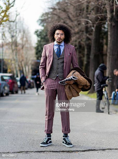 Kazim Sahin is wearing a pink suit Vans on January 10 2017 in Florence Italy