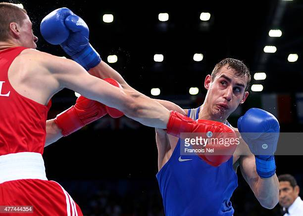 Kazimierz Legowski of Poland and Maxim Dadashev of Russia compete in the Mens Light Welterweight Round of 32 bout during day five of the Baku 2015...