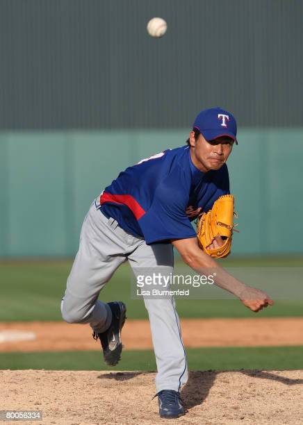 Kazou Fukumori of the Texas Rangers pitches during the game against the Los Angeles Angels of Anaheim at Tempe Diablo Stadium on February 28 2008 in...