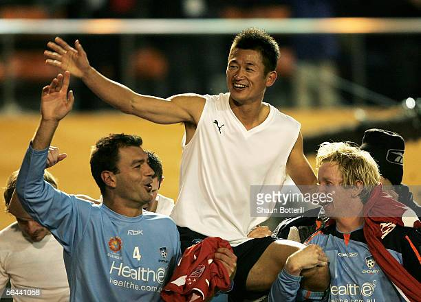 Kazu Miura of Sydney FC is carried on the shoulders of his teammates after the FIFA Club World Championship Toyota Cup 2005 match between Al Ahly and...