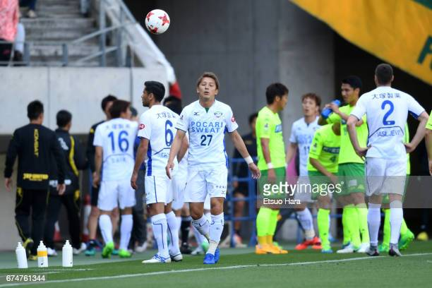 Kazuaki Mawatari of Tokushima Vortis is sent off after throwing the ball and pushing a ball boy during the J.League J2 match between JEF United Chiba...