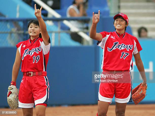 Kazue Ito and Yukiko Ueno of Japan gestures during the Softball Preliminary match between Canada and Japan at the Olympic Softball Stadium during day...