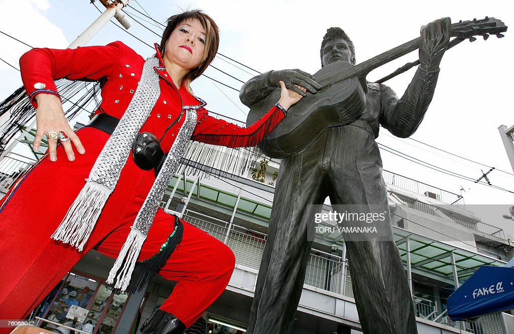 Kazue Osawa clad in her red jumpsuit pos : News Photo