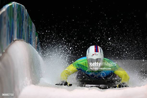 Kazuhiro Koshi of Japan competes in the men's skeleton fourth heat on day 8 of the 2010 Vancouver Winter Olympics at the Whistler Sliding Centre on...