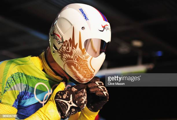 Kazuhiro Koshi of Japan removes his helmet after his final run in the Men's Skeleton on day 8 of the 2010 Vancouver Winter Olympics at the Whistler...
