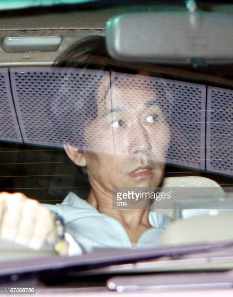 Kazuhiro Ogawa who was arrested on suspicion of an arson attack on a video shop leaves a police station to the Osaka detention center on October 2...