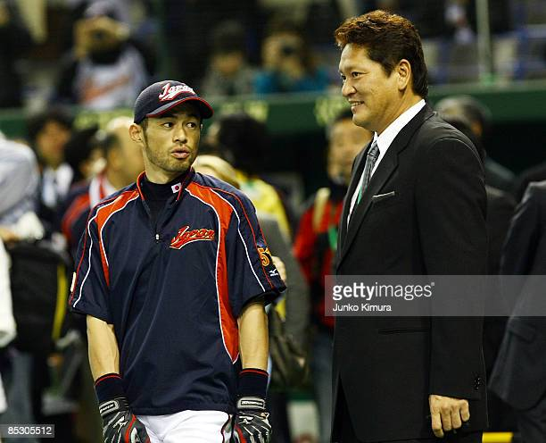 Kazuhiro Sasaki a former Seattle Mariners pitcher and Outfielder Ichiro Suzuki of Japan attend the practice session before the World Baseball Classic...