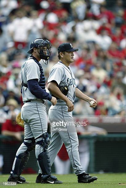 Kazuhiro Sasaki and Dan Wilson of the Seattle Mariners talk as the walk to the mound during the game against the Anaheim Angels at Edison Field on...